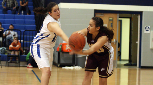Morgan Malik blocks a pass by a Lady Hawk player in Tuesday night's game. (Courtesy Photo)