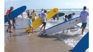 Seen here is a group surfing for the Interna¬tional Surfing Day Children's Surf Clinic on SPI on June 20.