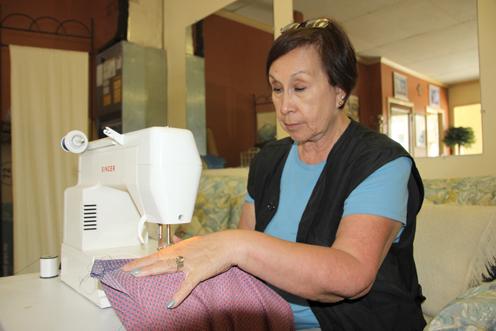 Mary Cantu sews