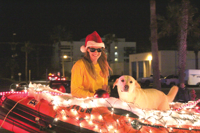 Scenes from recent events, including the South Padre Island Christmas Parade and Santa Mobile festivities are pictured here, including the Port Isabel Lighthouse illuminated in blue and decorated with holiday lighting. (Staff photos)