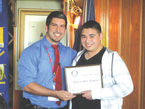 Anselmo Garza Jr. of the Port Isabel Rotary Club recognizes Juan C. Romero as Student of the Month.