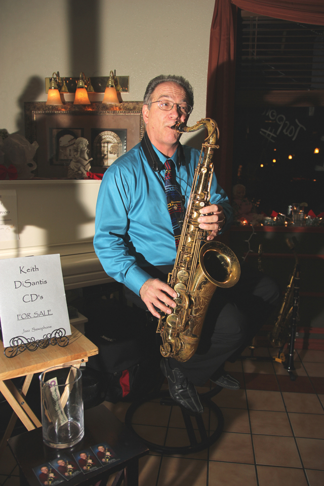 Keith DiSantis, an accomplished musician and local band director, is seen here with his tenor saxophone. DiSantis currently performs at Marcello's Italian Restaurant, located at  Port Isabel. (Staff photo by Ray Quiroga)