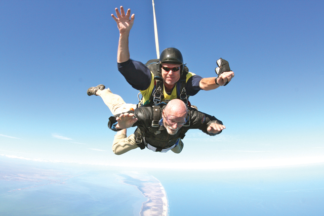 Ninety-year-old Russell Louden is seen before and during his recent skydiving experience. (Courtesy photos)