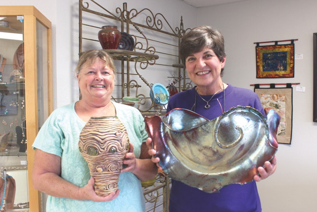 Lynne Anderson (right) recently donated some of her work to SPI Art Space. (Staff photo by Craig Alaniz)