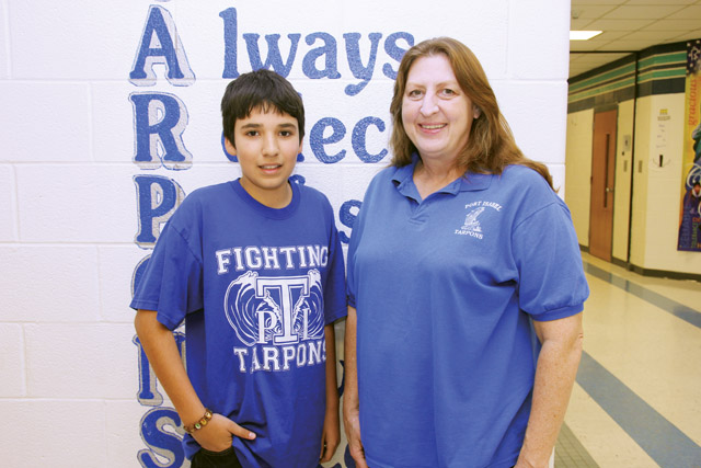 Michael Bernard is seen here with his spelling coach Cindy Denny a day before competing at the Rio Grande Valley Regional Spelling Bee. The Port Isabel Junior High School student finished in the top 20 at the contest. (Staff photo by Ray Quiroga)