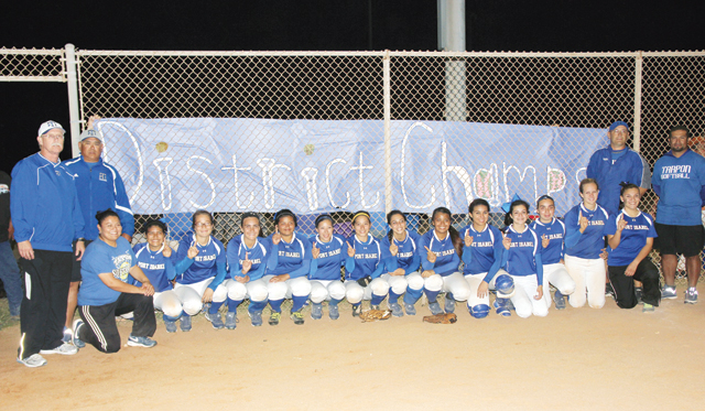 The Port Isabel Lady Tarpons celebrate after winning the district crown on Tuesday against La Feria. (Staff photos by Ray Quiroga)