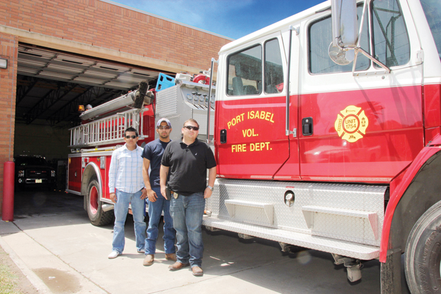 Port Isabel Volunteer Fire Department firefighters seen are Luis Perez, Greg Ruiz and John Sandoval. (Staff photo by Ray Quiroga)