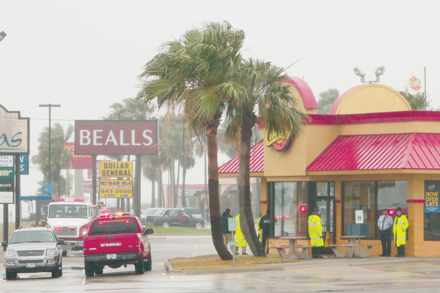 """Local authorities converged at a shopping center in Port Isabel, where the Brownsville Police Department Bomb Squad investigated a suspicious package with the letters """"TNT"""" written on it. (Staff photo by Craig Alaniz)"""