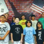 Olympian Taekwondo Academy students, from left, (front row) Aaron Villareal, Mack Stackwell, Ian Galvan and Evan Galvan; (back row) Tom Kuhn, Maya Rausch, Bethany Martinez, Elliot Carter and Coach Peter Caceras will compete this week in the National Championship representing Port Isabel.