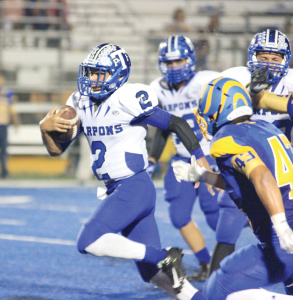 (Staff photo by Ray Quiroga) Senior quarterback Marco Colorado of the Port Isabel Tarpons is seen running down the field against Valley View on Friday, Sept. 19.