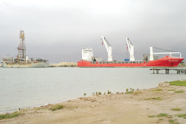 (Photo courtesy of the PISBND) A Hansa Heavy Lift vessel, named the Hong Kong, arrived at the Port Isabel-San Benito Navigation District on Tuesday, Sept. 2, and departed Saturday, Sept. 6, after discharging 12 natural gas powered engines for use in a Valley electric power plant. The vessel shown left is a Nobel Drilling Inc. drill ship that is waiting for its next drilling job in the Gulf.