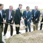 (Staff photos by Jacob Lopez) Local, state and federal officials are seen breaking ground on the SpaceX launch site at Boca Chica Beach in Brownsville on Monday, Sept. 22. Among those shown are SpaceX CEO Elon Musk (third from left), State Senator Eddie Lucio Jr. (fourth from left), State Representatives Rene O. Oliveira (fifth from left) and Eddie Lucio III (far right).