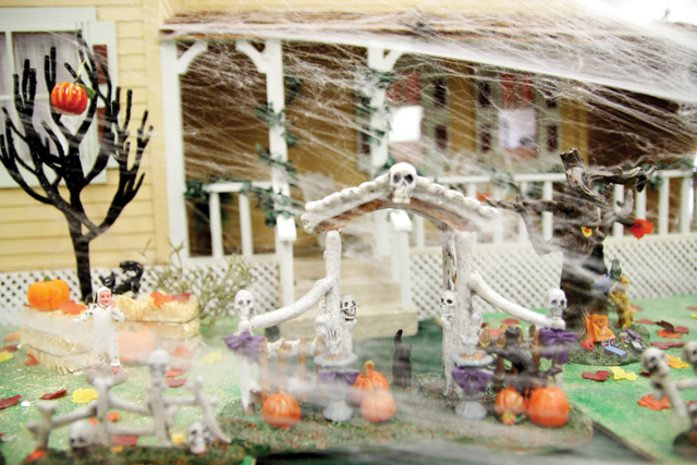 (Staff photo by Sergio Treviño) Darra Fuqua's haunted mini dollhouse is on display at the Port Isabel Library.