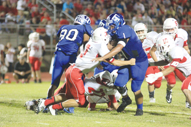"""(Staff photo by Ray Quiroga) Sophomore quarterback Sidney """"Trey"""" Mock of the Port Isabel Tarpons is seen breaking a tackle from a St. Joseph defender in recent football action."""