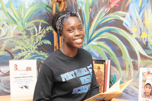 (Staff photo by Ray Quiroga) Amaya Lampkin, a junior at Port Isabel High School, is seen Wednesday, Oct. 8, inside a campus library.