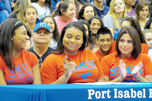 Going to SMU Port Isabel Lady Tarpon standout athlete and State shot put gold medalist Daniella Murchison is seen (center) Wednesday, Nov. 12 signing a letter of intent to attend Southern Methodist University (SMU) on a full scholarship. Murchison inked the letter inside the PIHS gymnasium while surrounded by family and coaches. (Staff photo by Estevan Medrano)