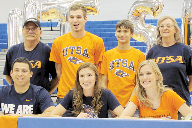 On the dotted line Port Isabel High School student-athlete Gabriyella Torres is pictured inside the PIHS gymnasium on Wednesday, Nov. 19 signing a letter of intent to attend the University of San Antonio (UTSA). (Staff photo by Estevan Medrano)