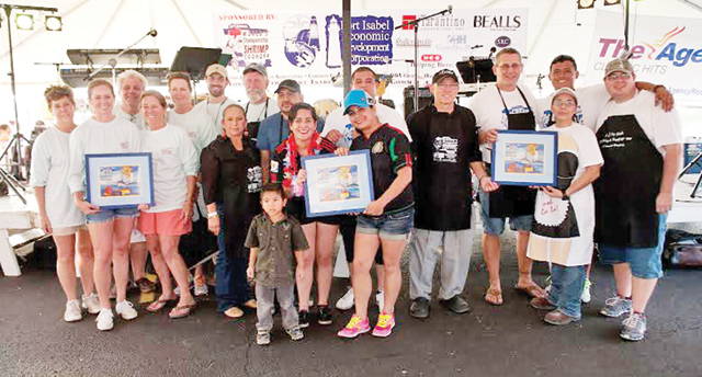 (Photo by Valerie Bates) Amateur division winners at Sunday's 21st Annual World's Annual Shrimp Cook-off in Port Isabel are seen. They are: Dennis and Renee Sanchez, first place; Delicias Express, runner-up; and Sutherlands Express, third place.