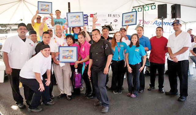 (Photo by Valerie Bates) This Sunday's Professional division winners of the 21st Annual World's Annual Shrimp Cook-off in Port Isabel are pictured. They are: Dirty Al's at Pelican Station, first place; Senor Donkey, second place; Palm Street Pier, third place; and Padre Rita Grill, Showmanship Award.