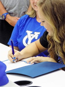 Kelcie Swink signs a letter of intent to play softball and basketball for York College. (Staff photo by Estevan Medrano).
