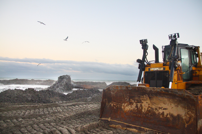 Dredging materials are deposited on the beach at South Padre Island. (Dina Arévalo | Staff photographer).