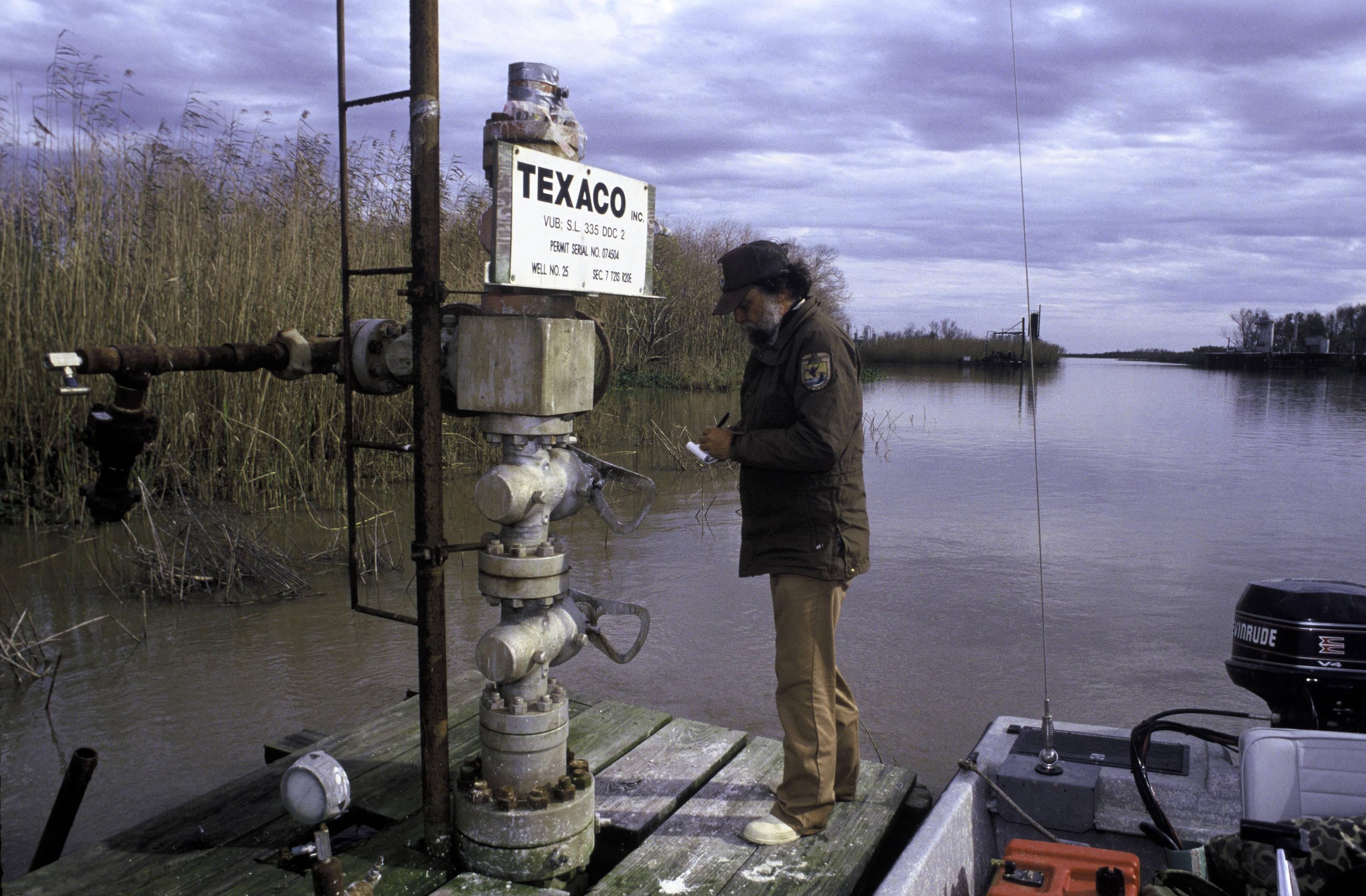 Checking_oil_well_on_Delta_National_Wildlife_Refuge