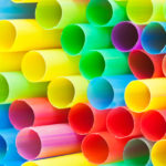 many ends of multicoloured plastic drinking straws close up